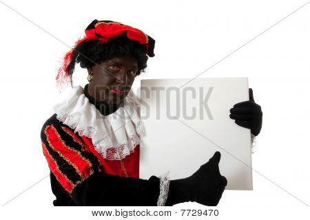 Zwarte Piet ( Black Pete) Typical Dutch Character Holding Board