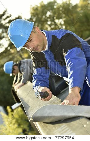 Carpenter sealing roof top terrace