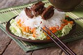 picture of chopsticks  - Asian rice noodles with meat and vegetables close - JPG
