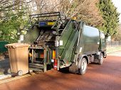 pic of trash truck  - Garbage truck with elevated wheelie bin in use - JPG