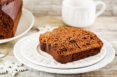stock photo of chocolate-chip  - chocolate bread with chocolate chips on a white wood background - JPG