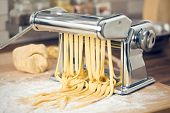 pic of pasta  - fresh pasta and pasta machine on kitchen table - JPG