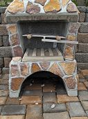 Outdoor fireplace from stone poster