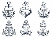 stock photo of navy anchor  - Marine or nautical themed ships anchor icons with blank ribbon banners entwined around the anchors - JPG