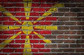 picture of macedonia  - Very old dark red brick wall texture with flag  - JPG