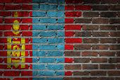 foto of mongol  - Very old dark red brick wall texture with flag  - JPG
