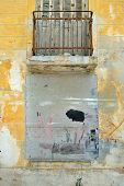 picture of oddities  - Bricked up window and weathered wall of an abandoned building - JPG