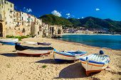 stock photo of old boat  - old wooden fishing boats on the beach of Cefalu - JPG