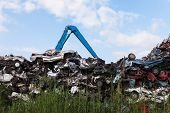picture of junk-yard  - Scrap yard with crushed cars and blue sky - JPG