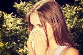 foto of hay fever  - Attractive young woman outdoor with white tissue - JPG