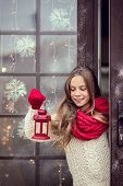 picture of guest-house  - Child girl welcome guests and holding holiday lantern - JPG