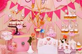 stock photo of buffet  - Delicious sweet buffet with cupcakes Sweet holiday buffet with cupcakes and meringues and other desserts - JPG