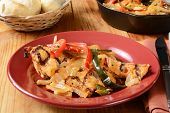 pic of poblano  - A plate of grilled chicken asada wiht red and green peppers - JPG