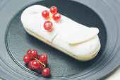 foto of eclairs  - Single eclair with space for text on white plate - JPG