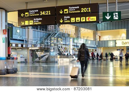 VALENCIA, SPAIN - FEBRUARY 14, 2015: Airline passengers inside the Valencia Airport. About 4.59 million passengers passed through the airport in 2013.