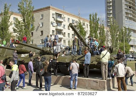 Children climb tanks removed from service in the Soviet army