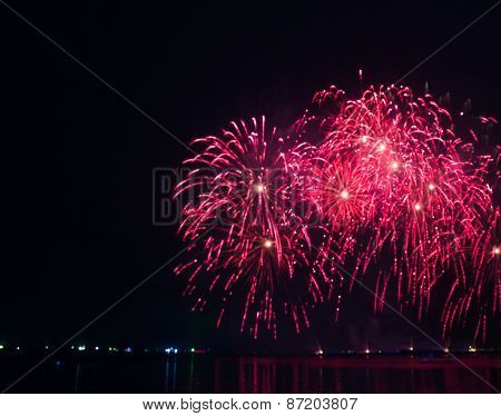 Abstract Red Bright Lights Blur Fireworks At Night Background