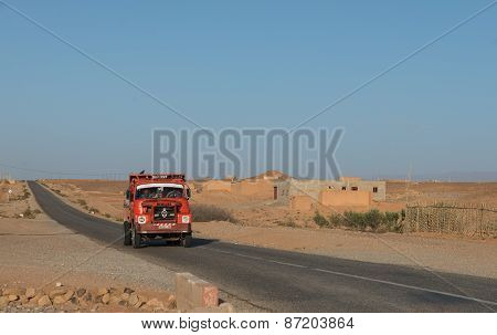 The African Driver Drive Red Truck In Morocco