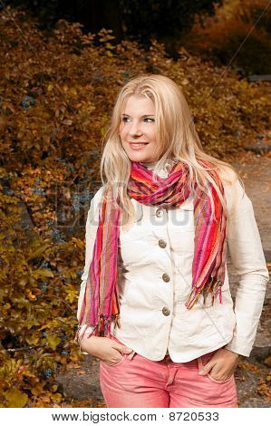 beautiful autumn woman in yellow park