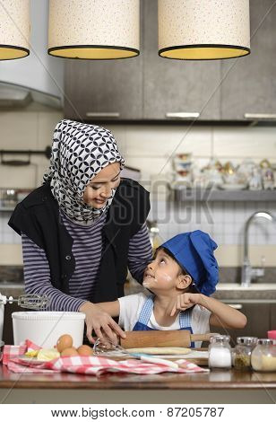 Moslem Woman Teaching Her Daughter