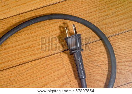 Electrical Cord on Wood Floor
