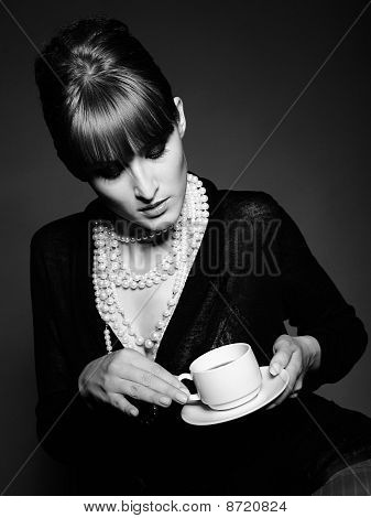 Beautiful Retro Woman With Red Lips Holding Cup Of Coffee. Black And White Picture
