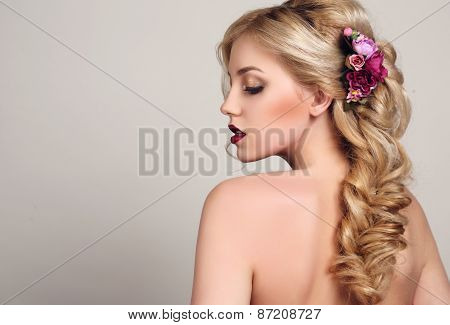 Woman With Blond Curly Hair With Bright Makeup And Flower's Hair Accessory