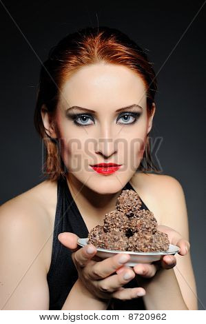 Beautiful Retro Woman With Red Lips Holding Many Truffel Shocolate Sweets.