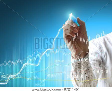 businessman hand writing a business graph