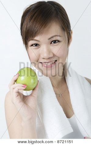 Asian Girl With Green Apple