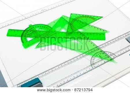 drawing board with measuring instruments on a white background