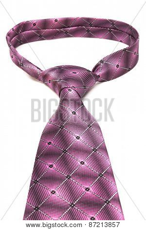 beautiful knot pink tie on white background