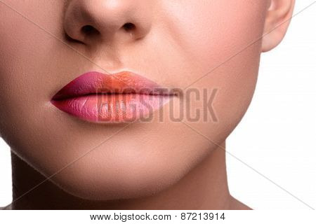 Close up lips shot of young woman posing, showing her tongue