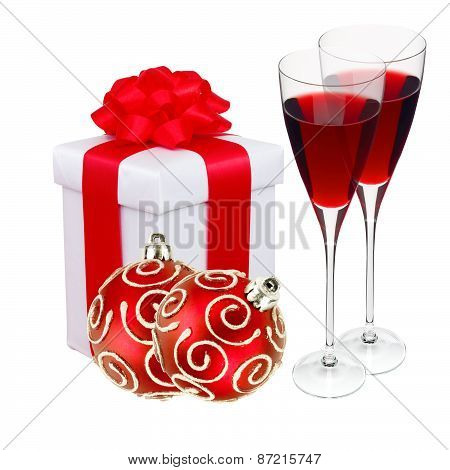 Beautiful Gift In White Packaging, Two Wineglass And Red Christmas Balls Isolated On White