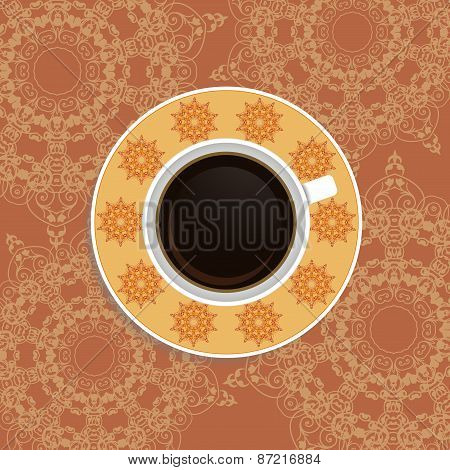 Cup of coffee with ornate eastern elements. Top view