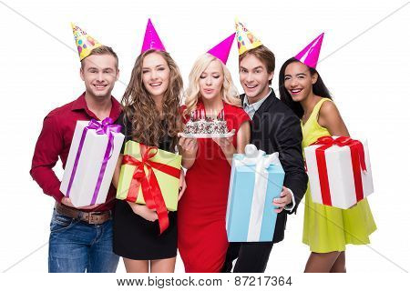 Happy people with birthday hats and colourful presents