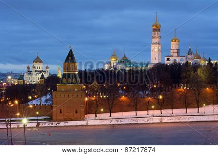 Bell tower of Ivan Great, Kremlin wall and Cathedral of Christ Saviour at evening in Moscow