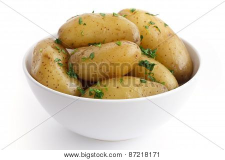Boiled baby potatoes with parsley.