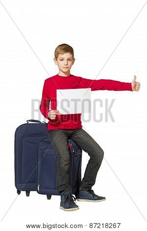 Boy Sitting On Travel Bags Holding Sheet Of Paper Thumb Up