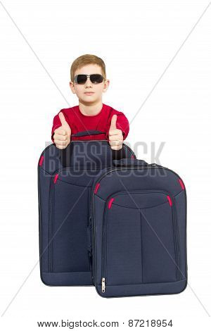 Portrait Of Boy Wearing Sunglasses Showing Thumbs Up With Travel Bags