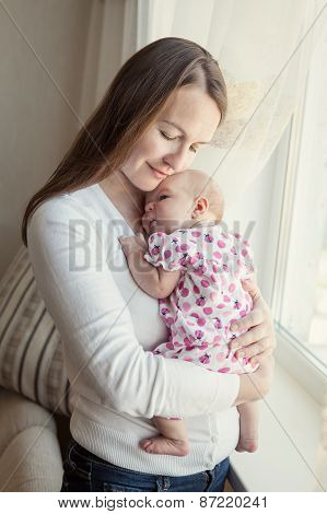 Happy Mother Hugging Little Daughter