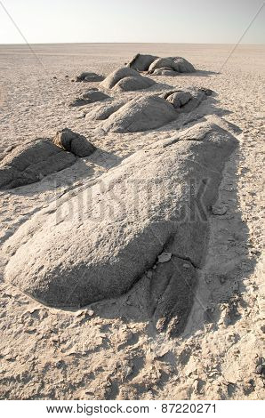 Granite Boulders In The Sand Near Kubu Island
