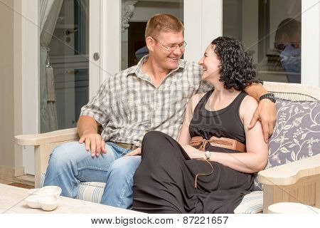 Young Couple Together On Patio