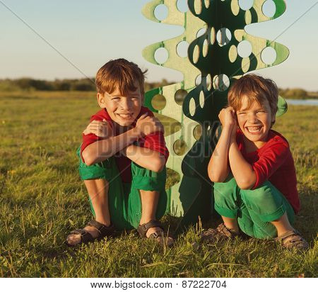 Happy Brothers Are Playing With Paper Tree