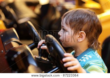 Boy At The Wheel Of Car Simulator