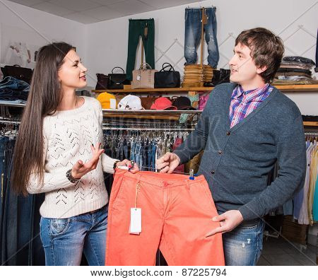 Shop Assistant Showing  Jeans