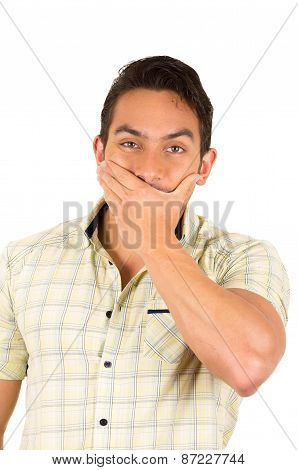 young handsome hispanic man expressing surprise
