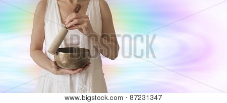 Sound Healer holding Tibetan Singing Bowl
