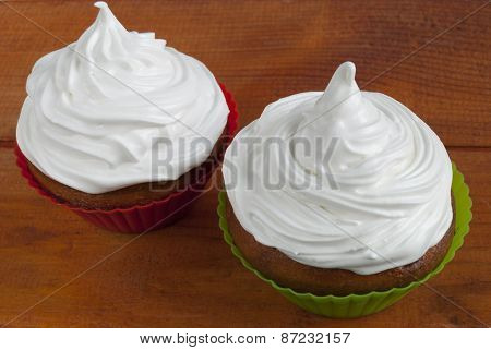 Sweet Couple Muffins Under A White Cream