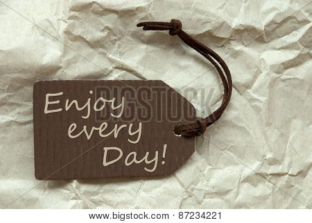Brown Label With Quote Enjoy Every Day Paper Background